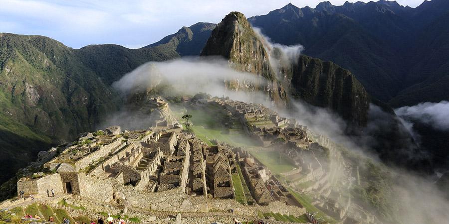 Machu Picchu submerged in a foggy cloud